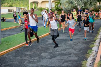 Runners at the beginning of the Elite Relay Exchange in the 25th Edition of the Mourant H. Lavity Stoutt Community College Classics Finale in Paraquita Bay, Tortola. Photo: Michael Jack/HLSCC