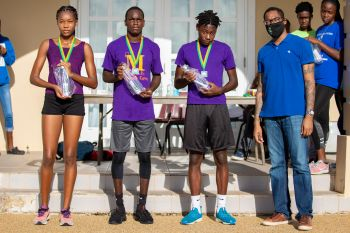 Team Talent X runners Jelani Croal, Rashawn Jack and Lia Claxton receiving their awards at the Elite Relay Exchange in the 25th Edition of the Mourant H. Lavity Stoutt Community College Classics Finale in Paraquita Bay, Tortola. Photo: Michael Jack/HLSCC