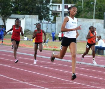 Beyonce Defreitas started the evenings sprint 'doubles' holding off Gia Malone to win the U13 100m. She would go on to win the 200m in a time of 26.57. Photo: Charlie E. Jackson/VINO