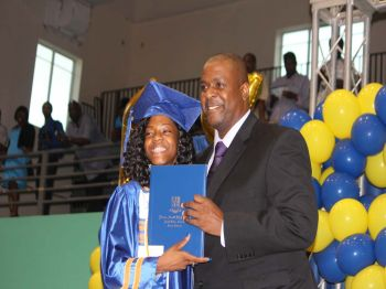 Leader of the Opposition and First District Representative, Honourable Andrew A. Fahie presented his daughter, Kedisha Fahie with her diploma. She graduated with honours and as a dual enrollment student. Photo: VINO