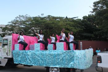 Pageant contestants wave to the crowd during a motorcade held on January 18, 2013. Photo:VINO