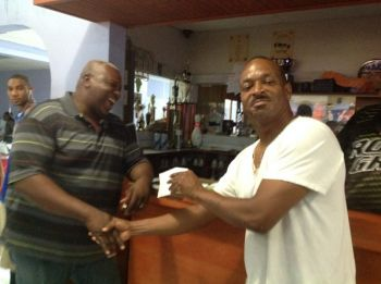 Bernard Grant (right) receiving his third place prize from President of the VI Bowling Federation, Mr. Ronald Moorehead. Photo: Provided