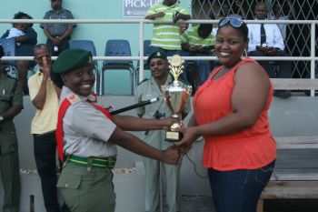 Staff Sgt. Jillian Charles receiving the Trophy for the Senior Squad from Deputy Chairman of the VICC Board, Ms. Drusilla Fahie. Photo: VICC
