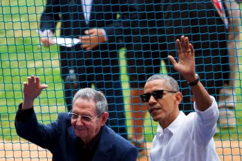 U.S. President Barack Obama, right, and Cuban President Raul Castro wave to fans as they arrive for a baseball game between the Tampa Bay Rays and the Cuban national baseball team in Havana on Tuesday, March 22, 2016. Photo: TIME