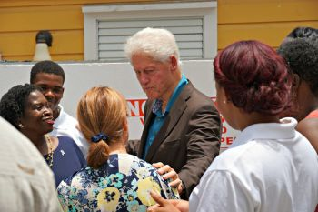 President Clinton speaks with residents following a press conference at the Family Resource Center in St Thomas. Photo: VI CONSORTIUM