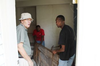 The clean-up activity of the Old HM Prison commenced this morning with approximately one dozen crew members and two students of the H. Lavity Stoutt Community College (HLSCC) - Kevin Liburd and Jonathon Cruz (in Picture). At left is Mr Hugh R. Whistler. Photo: VINO