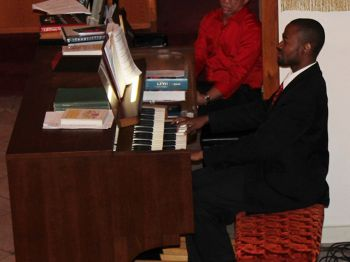 Quinson Thomas at work on the church organ during the concert. Photo: VINO