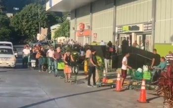 Shoppers outside RiteWay Food Markets in Pasea Estate early this morning, March 26, 2020. Photo: Facebook