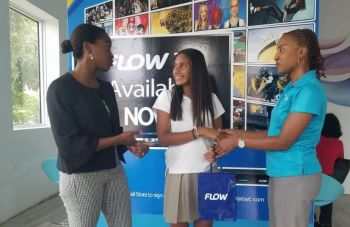 Marketing and Communications Manager of Flow, Mrs Nadia James-Harris (right) presents a Samsung Galaxy S9 as the second prize for the fundraising raffle by Ariel Mohamed (centre), while Director of Family Support Network Mrs Sasha Stoutt offers words of gratitude. Photo: Provided