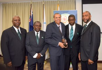 Members of the BVIOC Executive with Reynold S. 'Rey' O'Neal, OBE at a tribute evening hosted for him by the BVIOC on January 23, 2016 where he received the IOC Pierre de Coubertin Trophy in recognition of his outstanding efforts in promoting and encouraging the practice of sports in the [British] Virgin Islands and the Caribbean, and for being an inspiration to all involved in sports. Photo: BVIOC