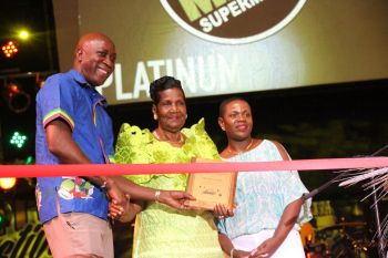 Rita Francis (with plaque) is flanked by Minister for Education and Culture Hon Myron V. Walwyn (left) and Virgin Islands Festival and Fairs Committee Chairperson, Kishma A. Baronville. Photo: VINO