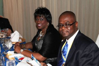 Rotarians Lynette Harrigan (left) and Ron Potter at the 45th anniversary dinner of the Rotary Club of Tortola. Photo: VINO