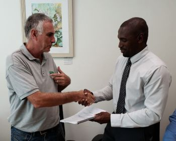 Royd Smurthwaite, Director of Ridgeview Construction (BVI) Ltd. and Clarence Faulkner, Acting Chair RDA's Board who signed the contract on behalf of the RDA. Photo: RDA