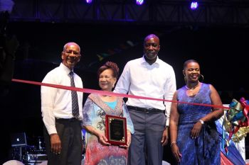 Lake flanked by Premier Smith on the left and Honourable Myron V. Walwyn. Also pictured is Chairperson of the VI Festival and Fairs Committee Kishma A. Baronville. Photo: VINO