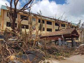 The Virgin Islands has recovered significantly since the passage of Hurricane Irma and Maria in September 2017. This damaged building of the Elmore Stoutt High School has since been repaired and renamed. Photo: VINO