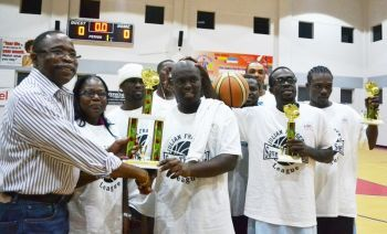 Ruff House receiving their trophy for winning the Hon Julian Fraser/Save the Seed League basketball championship last year. Photo: VINO/File