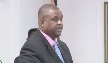 According to the Premier, Hon Andrew A. Fahie (R1), staff of the BVI House Asia will now only enter the office twice weekly for essential functions and documents. Photo: Youtube/HoA