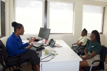 Ms Shamorie Glasgow (Cedar) and Ms Travencia Lettsome (7th Day Adventist) job shadow Stephane Burke, Country Manager CIBC FirstCaribbean. Photo: Provided