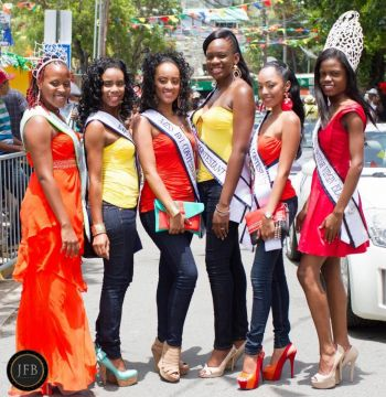 The St John Festival parade was graced with the presence of reigning Miss BVI and Caribbean World, Sharie B.Y. deCastro (right) as well as the four contestants for the upcoming Miss BVI pageant; Raemona Maloney, Brianna Henley, Mekyla Phillips and Rosanna Chichester. At left is Miss Teen BVI, Kamyce Penn. Photo: Provided