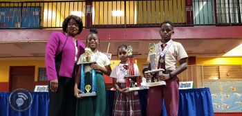 From left: Acting Chief Education Officer, Connie E. George; BVI Seventh-day Adventist Primary School student, Talisa Toussaint, who won the 2019 Spelling Bee in the primary division of the competition; second placed, Arianna Tillack, a student of the Althea Scatliffe primary School and third place winner, Zevieh Abraham of the Ivan Dawson Primary School. Photo: GIS