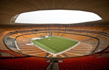 The 90,000-seat First National Bank Stadium in Soweto, South Africa, where global leaders will gather Tuesday for Nelson Mandela's funeral. Photo: BEN CURTIS/AP