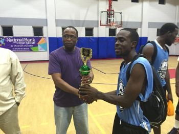 MVP Shamoii A. Dagou led the way with 22 points, 6 rebounds, and 7 assists while Charlesworth George knocked in 19 points, Ashfield Frett 17 with 16 rebounds and Travis Issac 15 with 13 rebounds. Here he receives his MVP trophy from tournament sponsor Hon Julian Fraser RA (R3). Photo: Provided