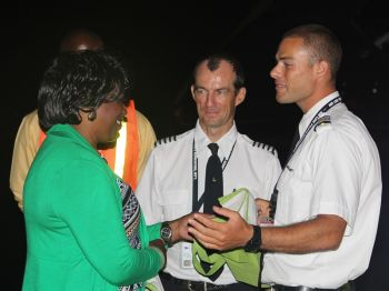 Niche Marketing Manager of the BVI Tourist Board, Lynette L. Harrigan (left) offers a token of appreciation to Captain Ronan Poinson (centre) and First Officer Stephen Neumann upon the occasion of American Eagle's final flight out of the Virgin Islands. Photo: VINO
