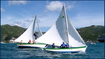 The 10th Annual Festival Sloop Shoot out became an exciting race as both boats were level half way around the course with gusting winds first driving the boats forward and then becalming them as the wind died. Photo: Provided