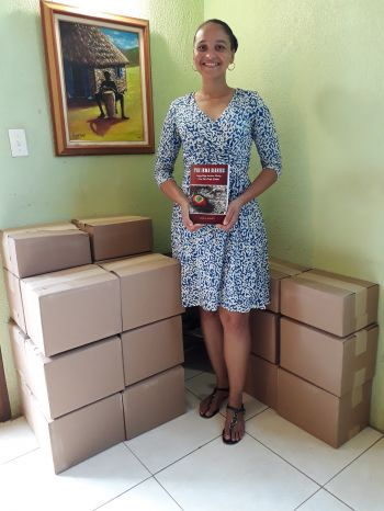 Five hundred hard copies of 'The Irma Diaries: Compelling Survivor Stories from The Virgin Islands' penned by local author, Angela Burnett Penn arrived on island today, Wednesday, March 15, 2018. Photo: Provided