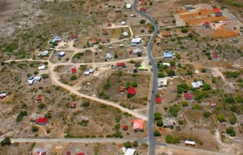 "According to the Minister, ""The people have been waiting too long to get land titles,"" however, he said that the initial focus will be on persons living in sections of The Settlement, Anegada. Photo: Internet Source"