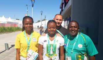 Tracy Bardshaw, swimming chaperone, Elinah Phillip (50m fly & 50m free), Coach Benoit Grattepanche, BVIOC President Penn, at Buenos Aires 2018. Photo: BVI Olympic Committee.