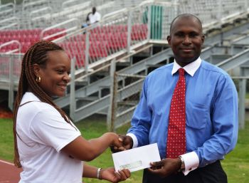 President of Ocean Conversion Mr Glenn Harrigan (right) presents the sponsorship cheque to Secretary of the BVI Twilight Association Ms Rosalind Leonard. Ocean Conversion will serve as a Platinum Sponsor of the upcoming BVI Twilight Invitational Track Meet hosted by the BVI Twilight Association. Photo: Provided