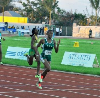 Tarika Moses then upped the ante with a Silver Medal winning performance of 55.83 in the Girls U-17 400m. Moses advanced to the final, when she avenged a home loss to Guadeloupe's Sareena Carti last year, by winning her heat in 55.63 seconds. Photo: Cleave Farrington