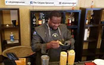 Mixologist Everson Rawlins in action at the Bartender of the Year Competition during Taste of the Caribbean 2019 in Miami, Florida. Photo: Team of Reporters