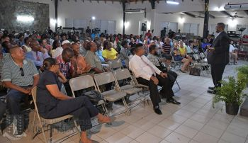 Premier and Minister of Finance Honourable Andrew A. Fahie (R1) addresses residents of Virgin Gorda during one of his many consultation meetings on regularisation in May 2019. Photo: Facebook