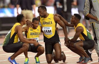 The legend Usain St Leo Bolt is assisted by his teammates. Photo: Instagram