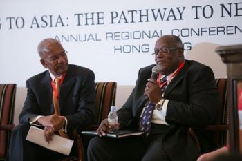 Dr Robert A. Mathavious (right) alongside former Premier Dr. D. Orlando Smith at the inaugural launch of Regional Business BVI Asia Conference in Hong Kong on September 11, 2014. Photo: BVI House Asia