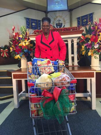 Verna Thompson won the shopping cart full of groceries and reusable Crisco branded shopping bags in which to take the items home. Photo: Provided