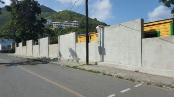Former legislator Myron V. Walwyn is still the subject of a criminal investigation over a $1.6M small wall constructed around the Elmore Stoutt High School (ESHS), according to Police Commissioner, Michael B. Mathews. Photo: VINO/File