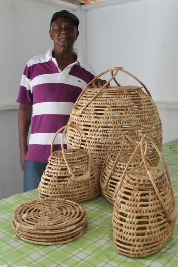 Mr Bovil P. Fergusson and some of his handicraft, baskets and place mats made of pwin wind aka Coppra. Photo: VINO