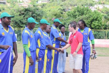 Digicel CEO Declan Cassidy congratulates the Vincy team following their tournament victory. Photo: provided