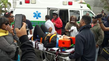A protester requires medical attention following a protest that turned ugly when police began pepper spraying Bermudians on December 2, 2016. Photo: Provided