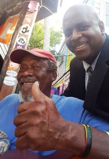 Opposition Leader, Andrew A. Fahie with JvD's favorite son—Mr Philiciano O. Callwood aka 'Foxy.' Photo: Team of Reporters
