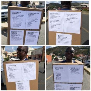 Residents bearing placards during the protest action. Photo: Team of Reporters