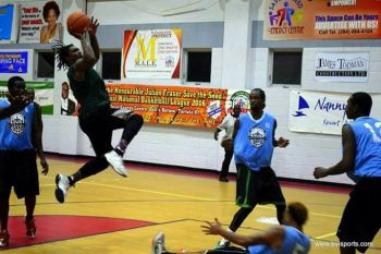 Action in the 2016 Honourable Julian Fraser's Save the Seed National Basketball League between 'West Gunners' (in Green) and 'Splash Brothers' (in blue). Photo: VINO/File