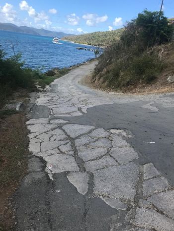 Getting off the ferry, visitors are greeted with some of the most dangerous roadways in the territory. Photo: Team of Reporters