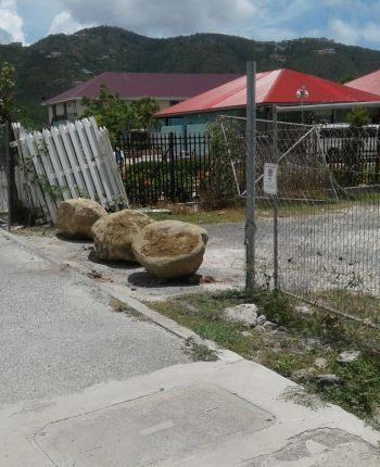 Several boulders have been placed at the entrance to the parking lot on Wickhams Cay, along with a sign warning that it is