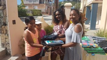 In a move to preserve his legacy as a community minded person, relatives on Sunday September 2, 2018, distributed back packs filled with school supplies for over thirty 30 children. Photo: Team of Reporters