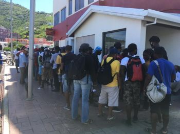 A long line of construction workers waiting to encash their cheques at the local CIBC Bank in Road Town, Tortola, on September 7, 2018. Photo: Team of Reporters