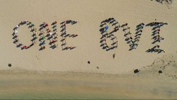 A human chain etched 'ONE BVI' in the sands of the Long Bay Beach at Beef Island as part of the Territory's one year observance activities marking the passage of Hurricane Irma on September 6, 2017. Photo: TRD Systems & Mapping